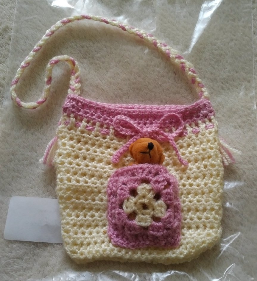 cream-and-pink-small-tassled-bag-1