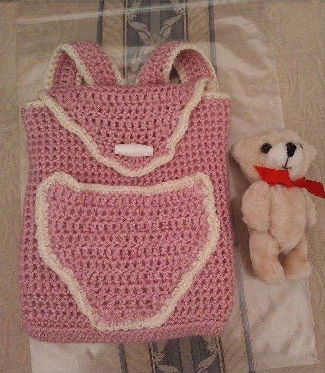 pink-backpack-teddy-outside-of-pocket-1