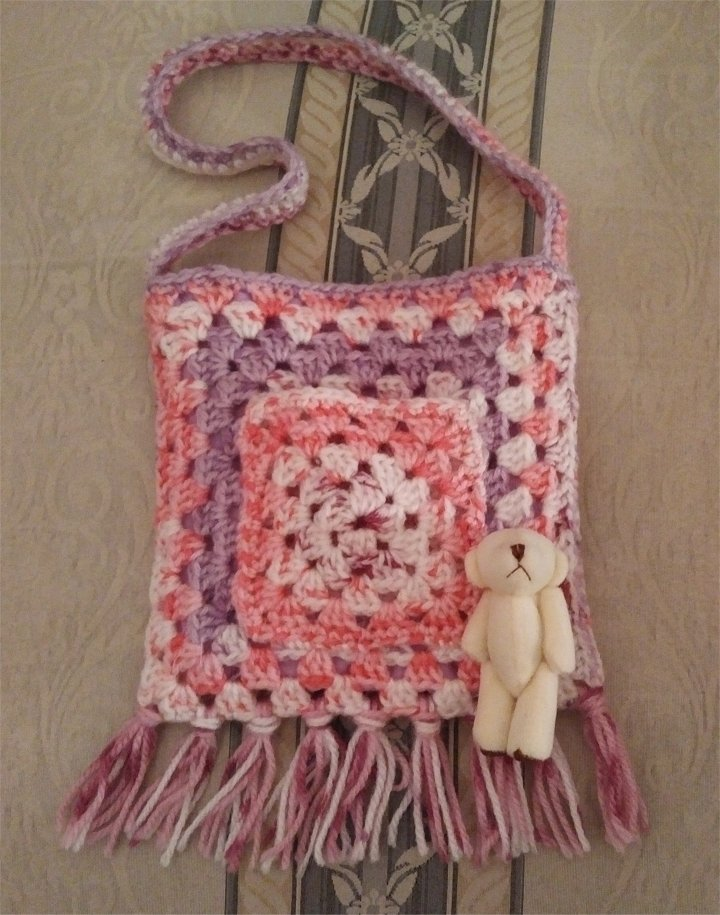 crochet-tassle-bag-pink-multi-teddy-outside