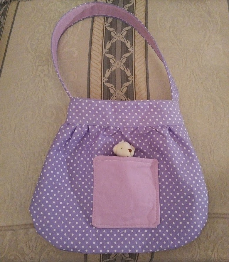 lilac-polka-dot-two-tone-bag-with-tiny-teddy-closer