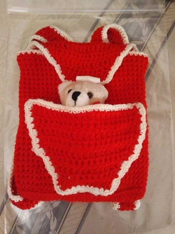 red-backpack-small-teddy-in-front-pocket