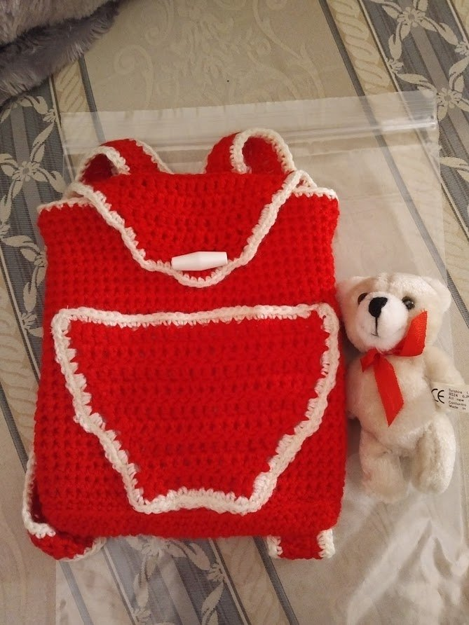 red-backpack-small-teddy-outside