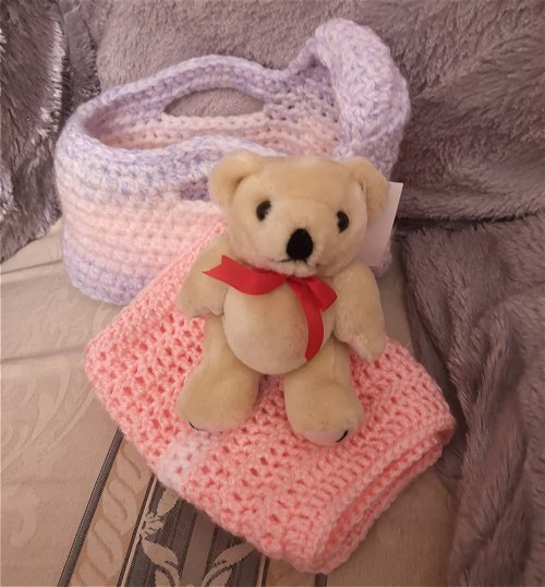 Teddy with a crochet moses basket and swaddling blanket
